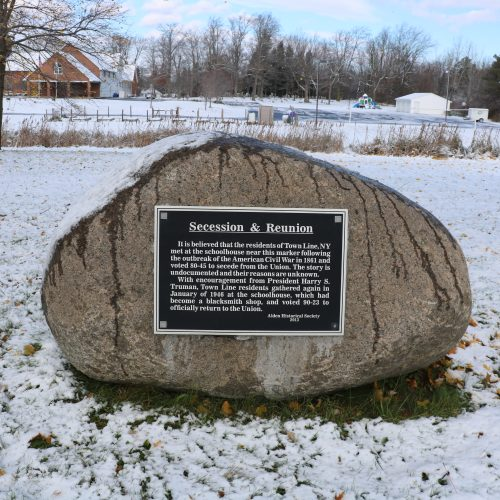 Secession & Reunion - It is believed that the residents of Town Line, NY met at the schoolhouse near the marker followign the outbreak of the American Civil War in 1861 and voted 80-45 to secede from the Union. The story is undocumented and their reasons are unknown. With encouragement from President Harry S. Truman, Town Line residents gathered again in Janyary of 1946 at the schoolhouse, which had become a blacksmith shop, and voted 90-23 to officially return to the Union. -Alden Historical Society (2013)
